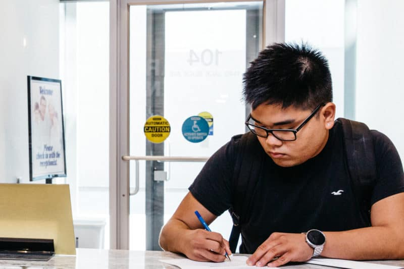 Young man filling out paperwork